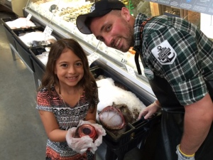 Sadie Rae and Josh the Fish-Slayer at Whole Foods